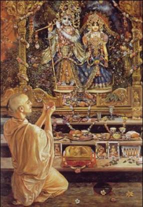 Offrande à la Murti de Radha Krishna par un dévot pujari